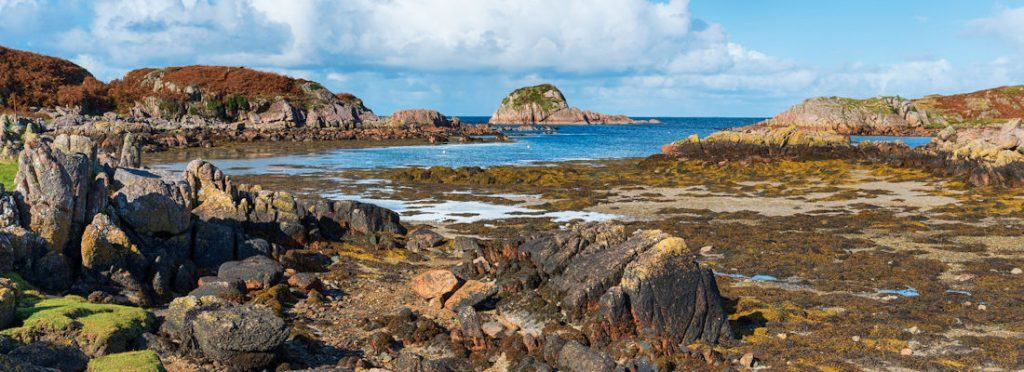 Rugged granite coastline at Kintra on the Isle of Mull in Scotland